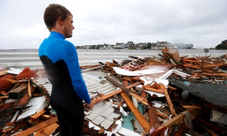 Currie Wagner looks over the debris from his grandmother Betty Wagner's house, destroyed by Sandy, in New Jersey. Photograph: Julio Cortez/AP
